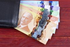 Canadian money in the black wallet Royalty Free Stock Photo