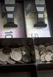 Canadian Money In Cash Register Drawer. Close-up of Canadian money in a cash register drawer royalty free stock image
