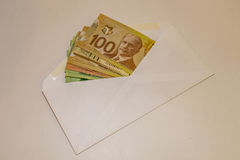 Canadian Money in an envelope Stock Image