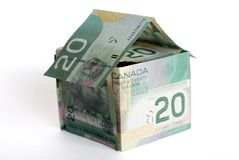 Canadian money house. On white background Stock Images