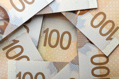 Canadian money. New one hundred canadian bills background Royalty Free Stock Image