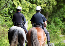 Canadian Mounted Police. Canadian policemen riding horses on patrol Stock Photos