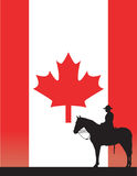 Canadian Mountie. The silhouette of a Canadian Mounted Police officer against a Canadian flag Royalty Free Stock Photo