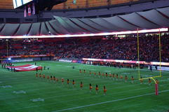 Canadian national flag at BC Place Stadium. During American football from Canadian Football League royalty free stock images