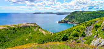 Canadian National Historic site  Fort Amherst, St John's Newfoundland. Sunny summer day over rocky coastline cliffs of Canadian National Historic site  Fort Royalty Free Stock Photos