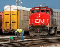 Canadian National switch man reroutes a locomotive. In the yard in Homewood, Illinois royalty free stock image