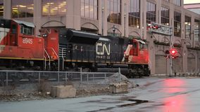 Canadian National Train Engines. DARTMOUTH, CANADA - APRIL 09, 2017: Train engines operating at urban crossing. Canadian National is a railway company based in stock video footage