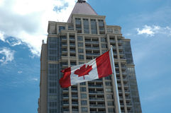 Canadian Office 2. Canadian office building with flag and blue sky close up royalty free stock photography