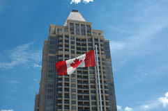 Canadian Office. Building in with flag and blue sky royalty free stock photo