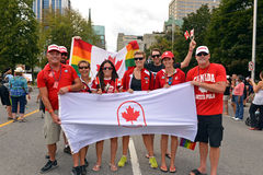 Canadian Olympians at Gay Pride in Ottawa. Ottawa, Canada – August 25, 2013:  A group of people, including Canadian ex-Olympic athletes, holds the Canadian Royalty Free Stock Photo