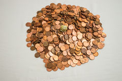 Canadian one cent coins and a little pig Stock Image
