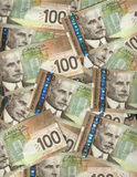 Canadian one hundred dollar bills. Background of Canadian one hundred dollar bills Stock Photos
