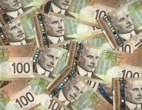 Canadian one hundred dollar bills. Background of Canadian one hundred dollar bills Stock Image