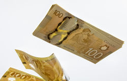 Canadian One Hundred Dollar Bills. One hundred dollar bills falling away from the stack Stock Images