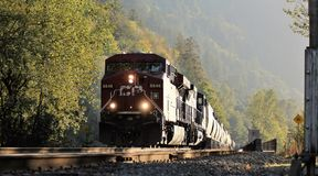 Canadian Pacific (CPR) Train. A Canadian Pacific train rumbles across a bridge over the Harrison River channel at Harrison Mills.  Canadian Pacific Railway Stock Photos
