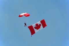 Canadian parachutist carrying flag Royalty Free Stock Image