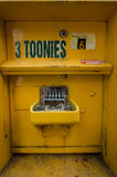 Canadian Parking Fare Box. A bright yellow parking fare box in downtown Toronto Royalty Free Stock Photography