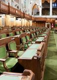 Canadian Parliament: the House of Commons. The House of Commons of the Canadian Parliament in Ottawa, Canada. The view on the row of chairs for the Members of stock photography