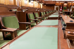 Canadian Parliament: the House of Commons. The House of Commons of the Canadian Parliament in Ottawa, Canada. The view on the row of tables for the Members of stock photo