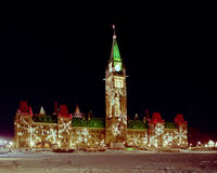 Canadian Parliament Lit for Christmas. Medium format film photograph of parliament lit up for the christmas holiday at night Stock Photos