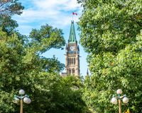 Canadian Parliament Peace Tower among trees stock photography