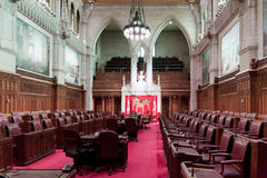 Canadian Parliament: the Senate. The Senate (the Red Chamber) of the Canadian Parliament in Ottawa, Canada. The general view of the chamber. The balcony for Royalty Free Stock Photos