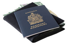Canadian passport and banknotes. Canadian passport and canadian 20-dollar bills in a black leather wallet Stock Photo