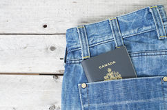 Canadian passport in blue jeans Royalty Free Stock Image