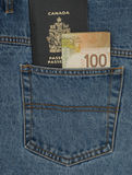 Canadian Passport and money. In a jeans pocket stock image
