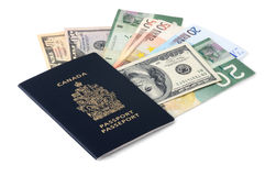 Canadian passport and paper money. Canadian passport and euro, US dollar and Canadian dollar banknotes Stock Images