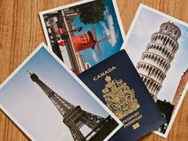 Canadian passport with selection of European travel photos on wo Royalty Free Stock Photo