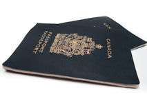 Canadian Passports. Two Canadian Passports, isolated on white Royalty Free Stock Photos