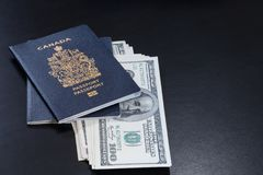 Canadian passports with Americans dollars banknotes entered into stock photo