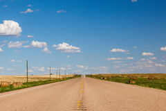 Canadian prairie road. A typical straight prairie road. Southern Alberta, Canada royalty free stock image