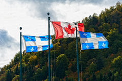 Canadian and the Quebec flag Stock Photo
