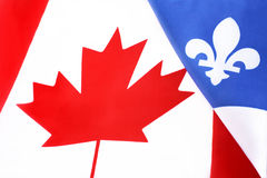 Canadian and Quebec flags Royalty Free Stock Photos