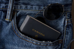 Canadian Ready to Travel with Passport and Shades Royalty Free Stock Photo