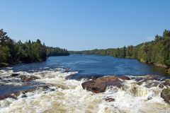 Canadian River. Beginning of rapids on the Quebec river Stock Images