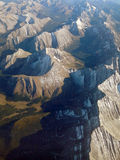 Canadian Rockies from the Air. Overview of the Canadian Rocky Mountains from the air.  Clear view of the rugged mountain range, the peaks, the valleys and the Royalty Free Stock Image