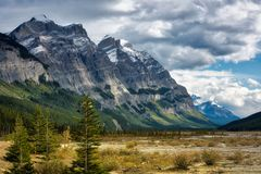 Canadian Rockies. Dramatic clouds over a peak in the Canadian Rockies royalty free stock photography
