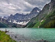 Canadian Rockies and Lake, Banff NP, Storm Clouds Scenery. Scenic mountains and lake in Canadian Rockies. Canadian landscape, Banff NP. Summer storm clouds on royalty free stock photos