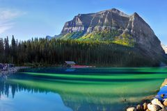 Canadian Rockies and Lake, Banff NP, Sunrise Scenery. Scenic mountains and Lake Louise in Canadian Rockies. Canadian landscape, Banff NP. Summer sunrise scenery royalty free stock photos