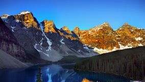 Canadian Rockies and Lake, Banff NP, Sunrise Scenery. Scenic mountains and Moraine Lake in Canadian Rockies, sunrise scenery. Canadian landscape, Banff NP stock photos