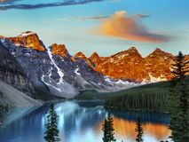 Canadian Rockies and Lake, Banff NP, Sunrise Scenery. Scenic mountains and Moraine Lake in Canadian Rockies, sunrise scenery. Canadian landscape, Banff NP royalty free stock photography