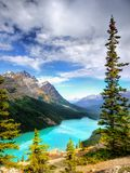 Canadian Rockies and Lake, Banff NP, Sunrise Scenery. Scenic mountains and Peyto Lake in Canadian Rockies. Canadian landscape, Banff NP. Summer sunrise scenery stock image