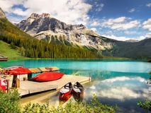 Canadian Rockies and Lake, Summer Vacation Scenery. Scenic mountains and Emerald Lake shore in Canadian Rockies. Canadian landscape, summer vacation scenery royalty free stock image
