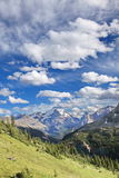 Canadian Rockies Mountain View with Large Emerald Blue, Partially Cloudy Sky Royalty Free Stock Photography
