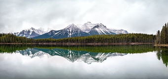 The Canadian Rockies mountains reflected in water Stock Images