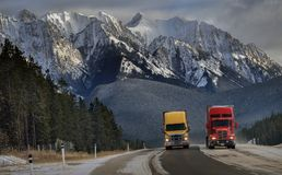 Canadian Rockies in winter. Trucks speeding on Trans Canada Stock Photography