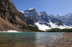 Canadian Rocky Mountains and glacial lake. Magnificent views of the Canadian Rocky Mountains and glacial lake at the foot of them, Alberta, Canada Royalty Free Stock Images